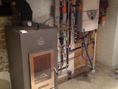 Toronto Boiler Installation by ductless.ca of a Laars boiler and Walltherm stove